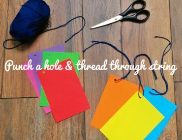 Punch a hole and thread through a string